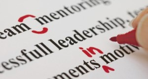 Hand with Red Pen Proofreading Text Closeup (iStock/Thinkstock)