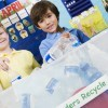 Children recycling together in their classroom.